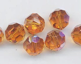 "Twelve ""out of program""  Swarovski crystals - Art. 5000 - 8 mm - topaz AB"