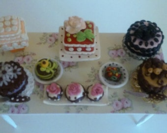 Miniature table of all different kinds of cakes