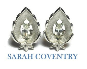 Sarah Coventry earrings,  1960s named 'crystal navette', marquise cut rhinestone crystal center, leaf shape, silver tone clip earrings