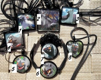 Poochyena and Mightyena Glass Pendants made from Trading Cards