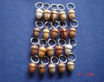 20 small wooden acorn keyrings in different woods