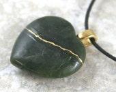 Broken heart pendant in jade with gold kintsugi (kintsukuroi) style repair on cotton cord - OOAK