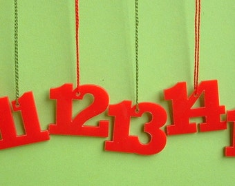 Advent calendar numbers 1-24 acrylic red trailer