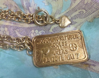 MINT. Vintage Moschino long chain classic necklace with large square plate with embossed logo, heart and love and peace mark