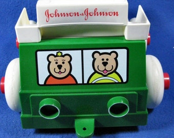 Vintage 1983 Johnson & Johnson Stack and Dump truck baby Sorting toy