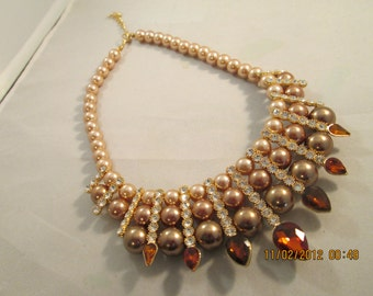 4 Row Bib Necklace with Shades of Beige Pearls,  Amber Crystal Beads and Clear Rhinestones