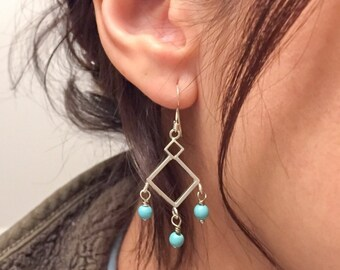 Silver chandelier earrings with natural stone