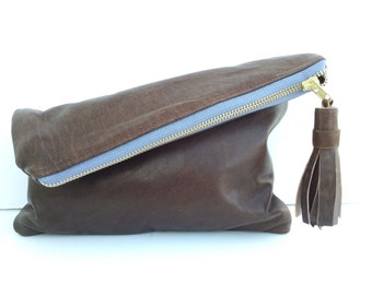 Leather tassel fold over clutch