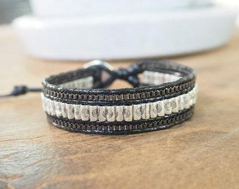 Balance rods silver plated black leather bracelet.