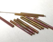 10 iridescent glass tube beads in green, purple, blue, and yellows