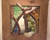 Reclaimed oak flooring frame, filled with natural sea glass sea stones and blueberry branches