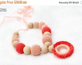 25% off Teething necklace with wooden ring pendant in pastel peach and coral. Nursing/breasfeeding mom accessory