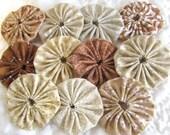 Yo yos 30 1 1/2  inch assorted  shades of  Tan