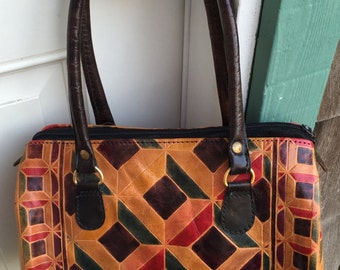Vintage leather handbag, Made in India, dyed or painted tooled geometric design, Boho Chic, cloth lining, inner zipper pocket, 1970's era