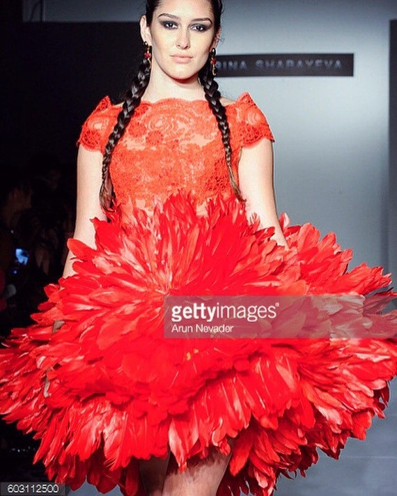 Irina Shabayeva Red Dahlia feather skirt with lace off the shoulder top.