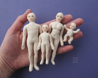 Cloth dolls 1:16 scale with faces. Posable dolls three quarter inch scale. Miniature mannequins. Dollhouse people. Tiny dolls house family.