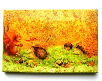 Painting collage and acrylic in soft autumnal squirrel and hedgehogs ready winter.