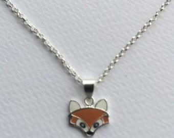 Tiny silver and enamel fox pendant