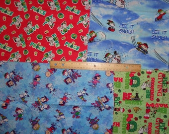 Four 22 x 28 Inch Peanuts/Snoopy Christmas Cotton Fabric Remnants