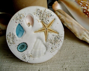 Clay and shell coasters (4). Absorbent drip free coasters for your beach home, boat or patio. Made in Florida. Handmade unique home accents.