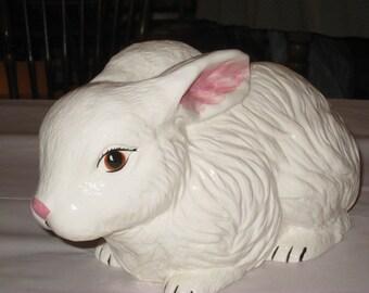 "Ceramic Bunny, white glaze, hand painted by Joan Davis, 13"" long"