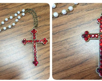 "Red Swarvoski crystal cross 28"" necklace."