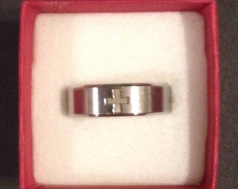 Ring Stainless steal with crosses on it size 10