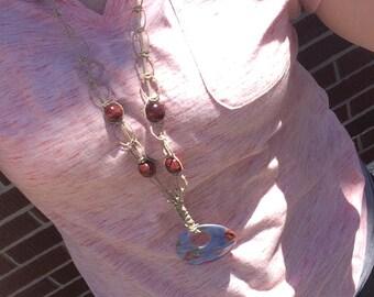 Long hemp necklace with blue pendant