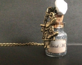 Alice-themed Drink Me necklace with rabbit charm