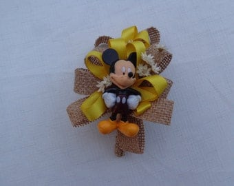 Mickey Mouse corsage trimmed with burlap