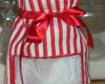 Reusable fabric gift bag with a peekaboo window in a red and white striped fabric