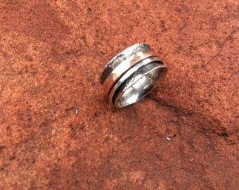 sterling silver triple spinner ring with anticlastic styling