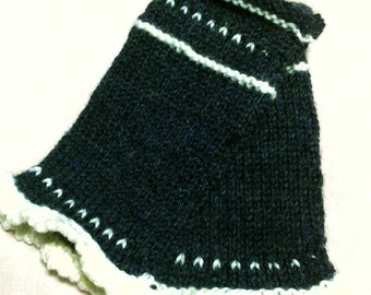 Handmade swedish black and white knitted wrist warmers. Really well made with a beautiful pattern. Handcraft