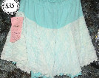 Adult Medium Skating/Dance skirt in Lycra features lace over-skirt.