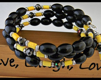 Black Glass and Yellow Bead Memory Wire Bracelet.