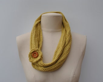Lightweight crocheted scarf in pale olive