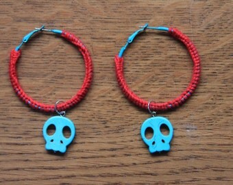 Crocheted earrings with blue skull