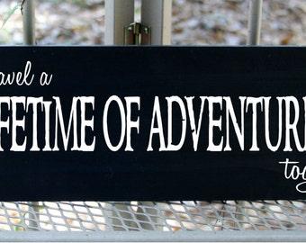 Lets travel a lifetime of adventures together wood sign