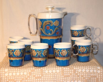 10 pc Thermo Designs drink set, pitcher, 4 glasses and 4 cups, very good like new condition, design by Helen Blanek