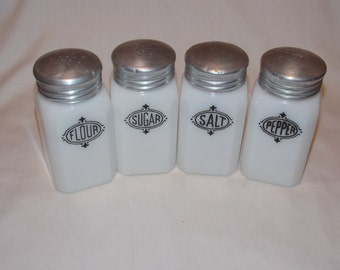Excellent Set of 4 White Glass Shakers