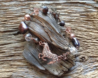 Beaded copper and rhinestone running horse bracelet: copper and blues horse bracelet