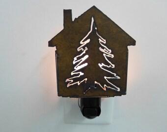 Pine tree nightlight image cut into rusted metal