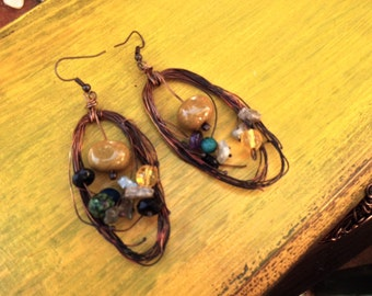 Earrings made with copper wire , jasper stone