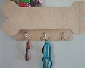 Doggy themed hide-a-shelf w/ storage compartment, and hooks for leashes and collars