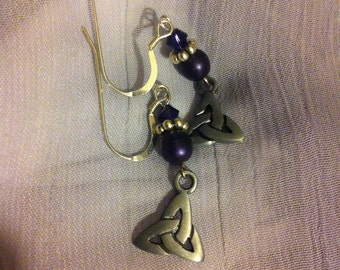 Dark purple and silver pierced earrings with Trinity knot charms.