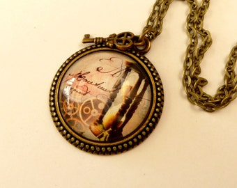 Steampunk necklace with hourglass and gears, Text necklace, round necklace, antique jewelry