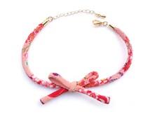Simple ribbon chirimen bracelet with a rhinestone charm, Gold color clasp, Japanese Kimono bracelet sliding knot cord / Pink orange