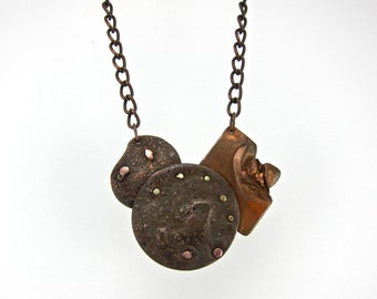 mixed metal, rustic statement necklace, discs, rivets