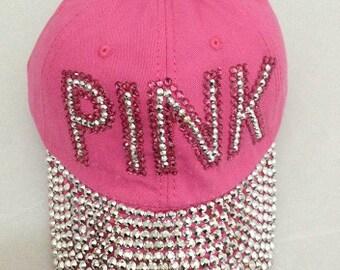 Fuschia Pink Rhinestud trimmed in Pink Cap
