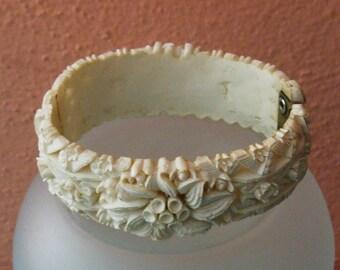 Carved white floral celuloid clamper bracelet
